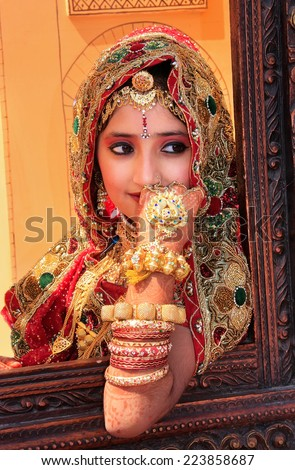 JAISALMER, INDIA - FEBRUARY 16: Unidentified girl takes part in Desert Festival on February 16, 2011 in Jaisalmer, India. Main purpose of this Festival is to display colorful culture of Rajasthan - stock photo