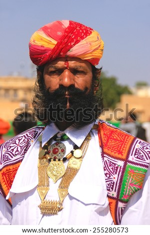 JAISALMER, INDIA - FEBRUARY 16: Unidentified man takes part in Mr Desert competition on February 16, 2011 in Jaisalmer, India. Main purpose of this Festival is to display colorful culture of Rajasthan - stock photo