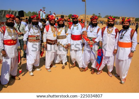 JAISALMER, INDIA - FEBRUARY 16: Unidentified men take part in Mr Desert competition on February 16, 2011 in Jaisalmer, India. Main purpose of this Festival is to display colorful culture of Rajasthan - stock photo
