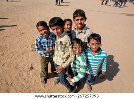 JAISALMER, INDIA - MAR 1: Unidentified children curiously looking around during the popular Desert Festival, Jaisalmer city, India  - stock photo