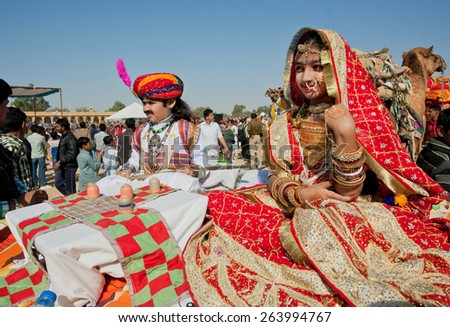 JAISALMER, INDIA - MAR 1: Unidentified children in beautiful indian costumes going to carnival during the famous Desert Festival on March 1, 2015. Every winter Jaisalmer takes famous Desert Festival - stock photo