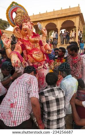JAISALMER, INDIA - SEPTEMBER 8th: Devotees carying the statue of Lord Ganesha during Ganesha Chaturthi festival on September 8th in Jaisalmer, India. - stock photo