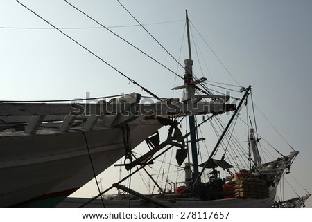 JAKARTA, INDONESIA - AUGUST 16, 2011: Wooden sailing ships called pinisi in the historical port of Sunda Kelapa in Jakarta, Central Java, Indonesia. - stock photo