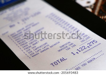 Jakarta, Indonesia- MAY 27 : The restaurant's bill in Jakarta on May 27, 2014. This bill claims less than 100 US Dollars, but has 7 digits because of the past inflation in Indonesia. - stock photo