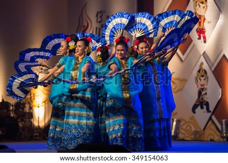 JAKARTA, INDONESIA: NOVEMBER 13, 2015: Dancers perform a traditional Javanese fan dance at the opening ceremony of the 13th World Wushu Championship 2015 in Jakarta Convention Centre. - stock photo