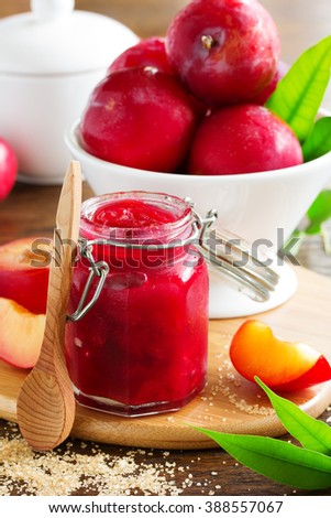 Jam from plums and slty on the table. - stock photo