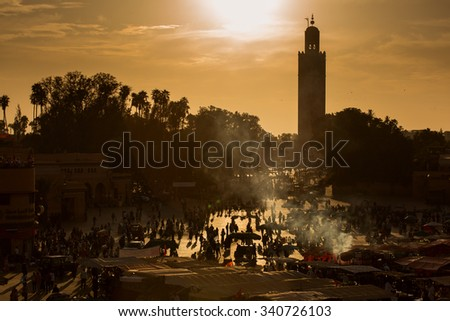 Jamaa el Fna (also Jemaa el-Fnaa, Djema el-Fna or Djemaa el-Fnaa) is a square and market place in Marrakesh's medina quarter (old city) with Koutubia in background. Marrakesh, Morocco, north Africa.