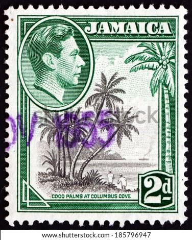 JAMAICA - CIRCA 1938: a stamp printed in Jamaica shows Coco Palms at Columbus Cove, circa 1938 - stock photo
