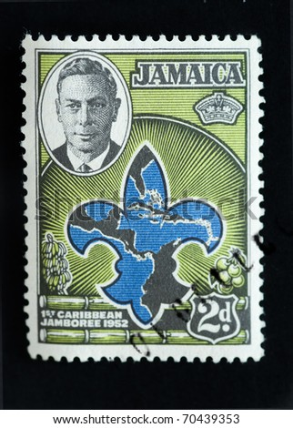 JAMAICA - CIRCA 1952 - Commemorative postage stamp marking the country's first scout movement jamboree circa 1952 - stock photo
