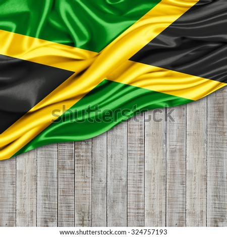 Jamaica   flag of silk with copyspace for your text or images and wood background - stock photo