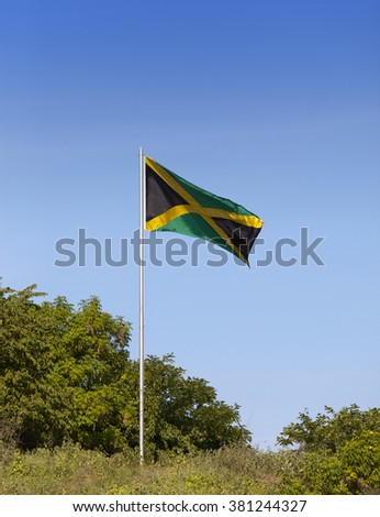 Jamaica. National flag on the green hill - stock photo
