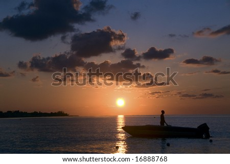 Jamaica Negril tropical vacation summer Caribean, ocean, seaside, boat, colorful, fishing, fishermen - stock photo