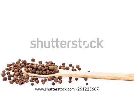 jamaica pepper in wooden spoon isolated - stock photo