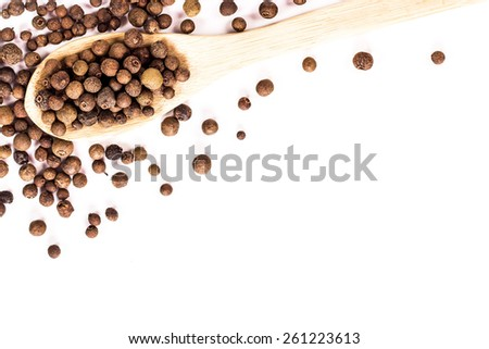 jamaica pepper in wooden spoon isolated. View from above - stock photo
