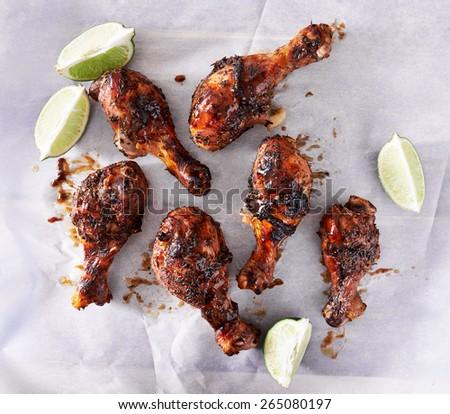 jamaican caribbean jerk chicken on baking paper - stock photo