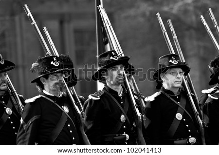 JAMESTOWN, VIRGINIA/USA - MARCH 18, 2012:  Black and white image of Civil War reenactors marching in formation during the Military through the Ages event on March 18 2012 at the Jamestown Settlement. - stock photo