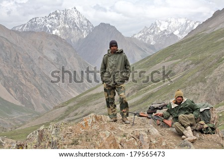 JAMMU AND KASHMIR, INDIA - JULY 17, 2006: Indian Army uniformed personnel in Kashmir Himalayas mountains. - stock photo