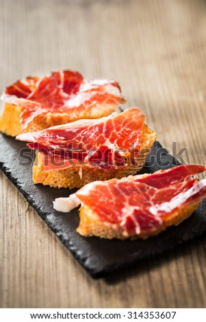 Jamon iberico, the best spanish ham tapas. Vertical copy space. - stock photo