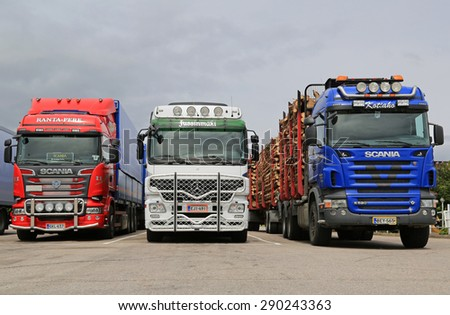 JAMSA, FINLAND -  JUNE 18, 2015: Scania and Mercedes-Benz Actros trucks at a truck stop. Road transport goes on throughout the Finnish celebration of Midsummer. - stock photo