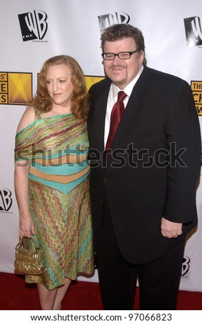 Jan 10, 2005; Los Angeles, CA:  Documentary filmmaker MICHAEL MOORE & wife at the 10th Annual Critcs' Choice Awards at the Wiltern Theatre, Los Angeles. - stock photo