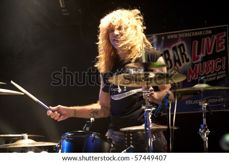 JANESVILLE, WI - JULY 16: Steven Adler (Guns n' Roses) performs with Adler's Appetite on their 2010 U.S. tour on July 16, 2010 in Janesville, WI. - stock photo