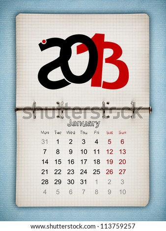January 2013 Calendar, open old notepad on blue paper - stock photo