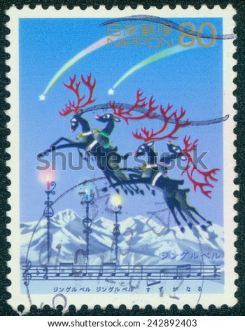 JAPAN - CIRCA 2000: A stamp printed in japan shows a Christmas scene with reindeer flying over the snow, circa 2000 - stock photo