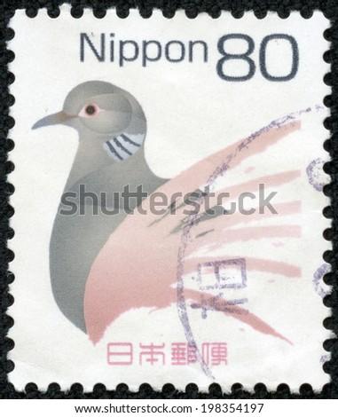 JAPAN - CIRCA 2000: A stamp printed in japan shows Abstract birds, circa 2000 - stock photo