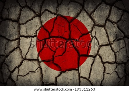 Japan flag painted on cracked soil - stock photo