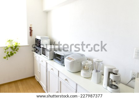 Japan kitchen with small cooking appliances are lined up - stock photo