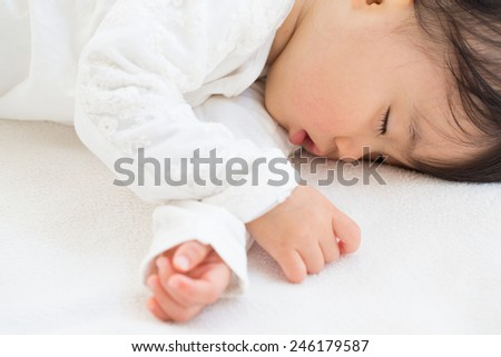 japanese baby sleeping - stock photo