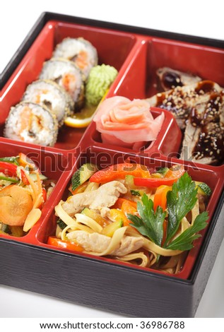 Japanese Bento Lunch - Salad with Cold Eel Appetizers and Hot Roll - stock photo