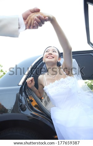 Japanese Bride getting out of the car - stock photo
