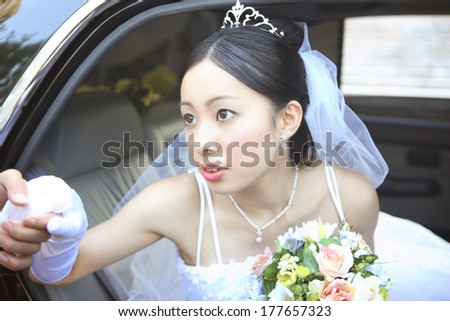 Japanese Bride to get off the car - stock photo