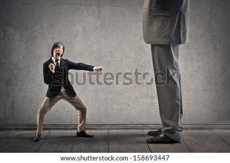 Japanese businessman attacks with karate moves a great man - stock photo