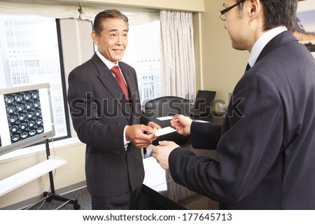Japanese Businessman to exchange business cards - stock photo