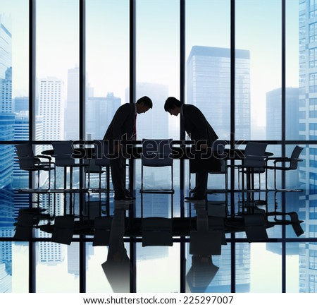 Japanese Businessmen Bowing Down Office Concept - stock photo