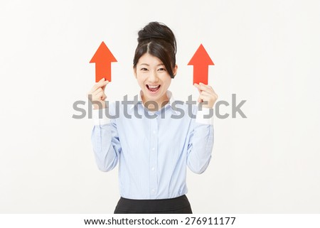Japanese businesswoman pointing up - stock photo