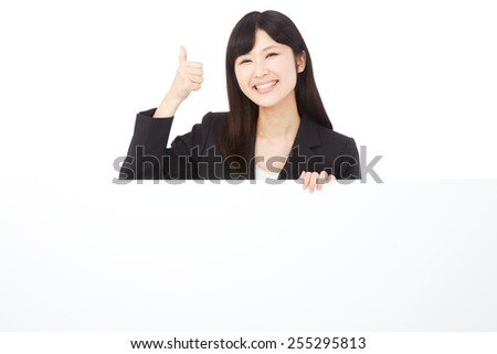Japanese businesswoman thumbs up gesture with Bulletin Board - stock photo