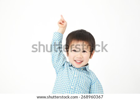 Japanese child pointing up - stock photo