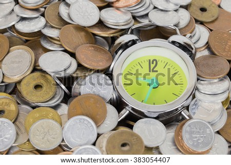 Japanese coins arranged against the clock. - stock photo