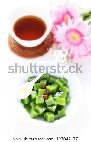 Japanese confectionery, green tea gelatin jelly with Mitsumame bean in diorama style - stock photo
