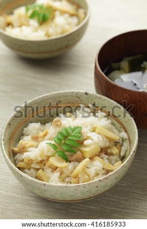 Japanese cuisine, Cooked rice with bamboo shoots and clear soup with bamboo shoots and wakame seaweed  - stock photo
