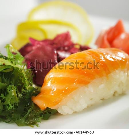 Japanese Cuisine -  Salmon Nigiri Sushi with Ginger and Seaweed - stock photo