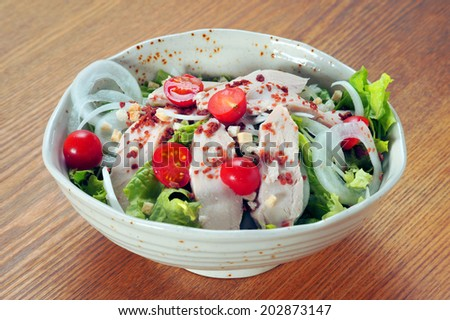 Japanese Cuisine-serving of healthy vegetables salad with chiken heart - stock photo