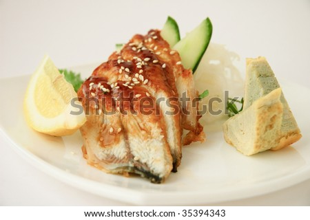 Japanese cuisine - sliced fried fish with omelet - stock photo