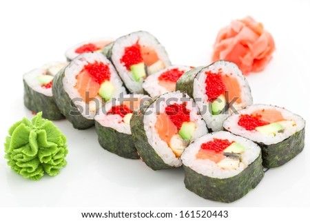 Japanese cuisine - sushi and rolls on a white background - stock photo