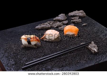 Japanese cuisine. sushi on background - stock photo
