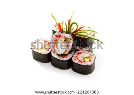 Japanese Cuisine - Sushi Roll with Crab Meat and Vegetables inside - stock photo
