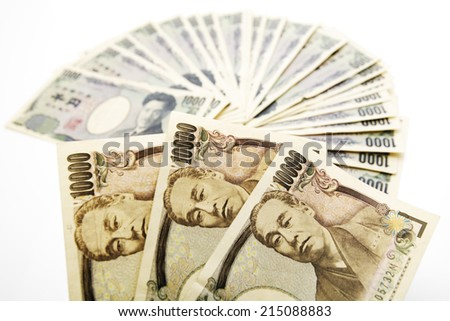 Japanese currency: ten thousand and one thousand yen banknotes - stock photo